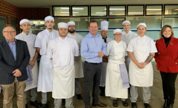Mark McGowan stands with hospitality students at Mandurah campus